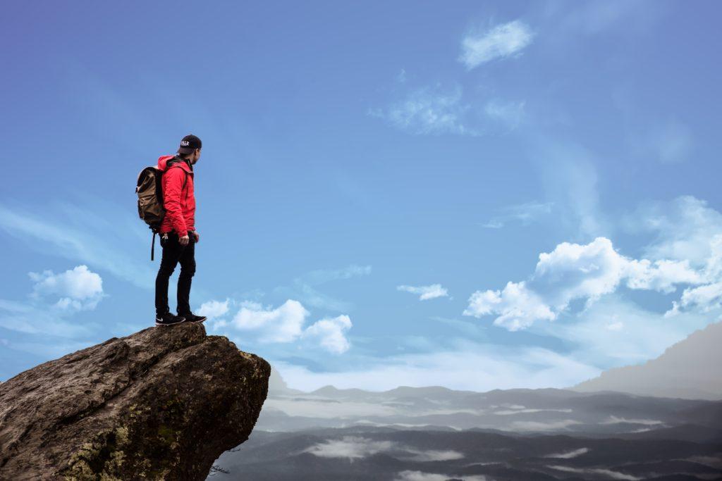 December 2017 Record EV Sales - Hiker on top of a rock