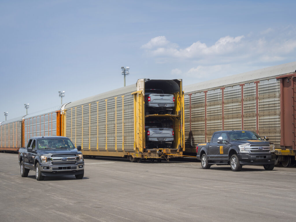 All-Electric F-150 Pulling rail cars with 42 F-150s-Source-Ford | Source: Ford